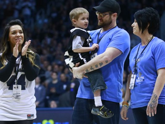 Samantha Smith, Deegan Scott, and Chase Stigall at the halftime of the Big East basketball game.